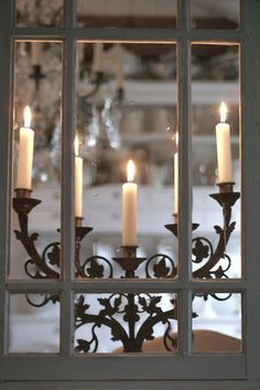 As the candelight bounced off the windows