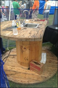 Turn a wooden cable spool into the perfect outdoor kitchen or garden sink!