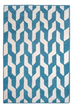 """Winter Home Buys - Change Out the Rugs    """"From The Rug Co.'s new, more accessible Studio Collection, this simple, very attractive weave pattern caught my eye in soft blue. Hand knotted of 100% Tibetan wool, it's also available in yellow and a neutral grey.""""    Cable Blue Rug, $1,128, available at Keep."""