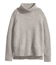 Black melange. Chunky-knit sweater in a cotton blend with a ribbed turtleneck. Raglan sleeves, slits at sides, and ribbing at cuffs and hem. Slightly longer