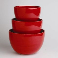 Saying goodbye to my mom's old mixing bowl. Love, love, love these red ones!  (Just received today... they're lovely!)