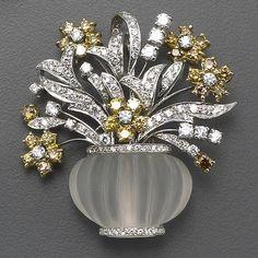A diamond, yellow diamond, rock crystal and bicolor gold brooch.