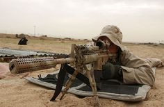 NAVY SEAL with M4A1 carbine fitted with an AN/PEQ-2 illuminator and Trijiicon ACOG sight.