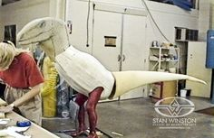 """SWS fabricator Marilyn Dozer-Chaney constructs the foam raptor """"Garbage Bag Test"""" over a life-cast of John Rosengrant."""