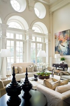 this livingroom shows symmetrical balance by placing to lamps on the two ends of the white couch