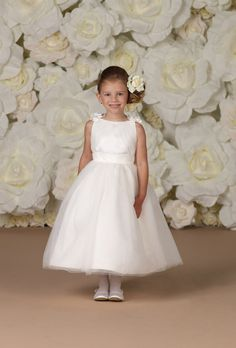 Brides: Joan Calabrese for Mon Cheri. Classic, jeweled satin, tea-length, sleeveless ball gown. Embroidered with sashes and ribbons.