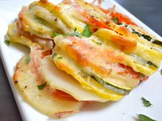Summer Vegetable Tian. Tomato, potato, onion, zucchini, yellow squash, garlic and cheese. #zucchini
