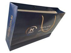 Branded paper bag with printing on all sides of the bag and gold rope handles