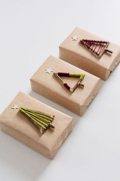 DIY Gift Packaging - Create twig Christmas trees, wrap with embroidery floss or wool to create colourful designs - idea: translate same look into tree decorations