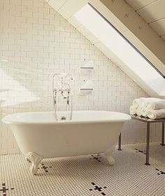 Love the hexagon mosaic tiles on the floor, the claw foot stand alone tub and the floor to ceiling white subway tiles in the master bath!