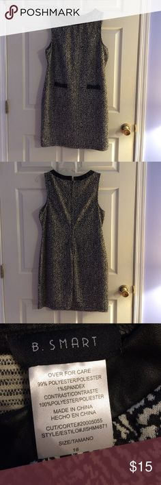 Black and White dress Black and white with leather trim collar and bows. Great condition! B.Smart Dresses Mini