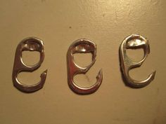 a survival fish hook made from a can tab.