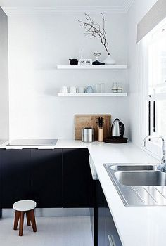 Crisp white splash back and benchtop with black cabinetry looks stunning