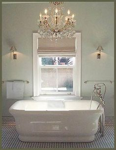 I've always wanted a bathtub with a chandelier.  I want more color in this one, though.