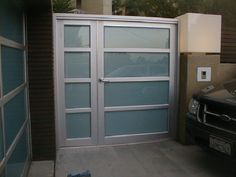 "Model: BP-450 Double Door | Size: 5′ x 6′ Frame: Clear Anodized Aluminum Glass: 1/4"" Laminated Obscured: Azurlite Location: Los Angeles, CA 90049 Front Gates, Entry Gates, Front Doors, Glass Garage Door, Garage Doors, Garage Office, Garden Gates, Exterior Doors, Double Doors"