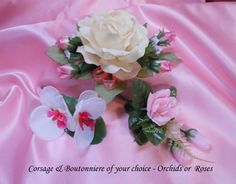 Corsages and Boutonnieres for special wedding guests can be purchased as sets or individually. Custom Corsages and Boutonnieres available.