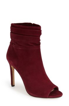A slouchy cuff lends edgy-sophistication to a sultry suede work-to-weekend bootie that easily transitions  maroon