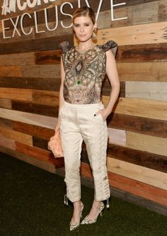 Kate Mara showed off a pair of the collection's lace-up pants and topped them with a printed blouse.