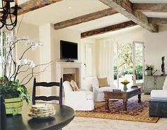 this is the look and feel I want for our living room... I also like the black table in the front... homework table gone black? hmmmmm.... Ohhhh and looky at the robins egg green table back there ooohhh so nice... and the beams, beams, beams, beams.... I love beams!