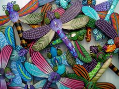 These are all dragonfly brooches. All the details you see are made in the millefiori technique (canework) in polymer clay.