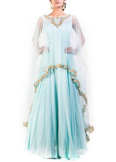 Aqua blue gown with long embroidered cape