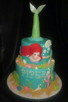 Buttercream iced cakes. fondant seashells, corals and of course Ariel.