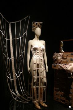 Jean Paul Gaultier's exhibition in KunstHal Rotterdam by Inspired by Traveling. Satin cage-look corset dress with maxi length train. www.inspiredbytraveling.nl