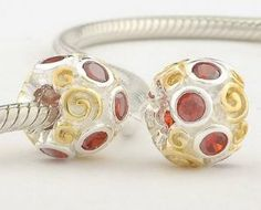 """925 Sterling Silver Gold Vermeil """"Primrose Path with Ruby Czech Crystal CZ July Birthstone"""" Charms/beads for Pandora, Biagi, Chamilia, Troll and More Bracelet general gifts. $18.99. Suitable for 3mm Cable Pandora and other European Charm Bracelets. Color: 14k gold + antique silver (oxidized) red CZ Crystal. Materials: 14k gold plated over 925 Sterling Silver (Stamped)and CZ. Quantity: 1pc. Hole Size: 4.5mm. Save 75% Off!"""