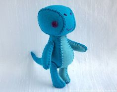 How adorable are is he!?  Alta the Brachiosaurus Wool Felt Plush Art Doll by nonesuchgarden  From nonesuchgarden on Etsy