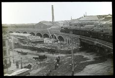 Steam train travelling easterly towards Flinders St Station over Spencer St along a recently constructed viaduct c.1890 with the new #Melbourne Fish Markets (demolished 1959) under construction. Adam Ford, Train Travel, Under Construction, Paris Skyline, Melbourne, Louvre, Victoria, Australia, Marketing