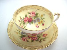 Very nice tea cup and saucer from Royal Sutherland, England yellow tea cup and saucer with flowers Gold scroll on both pieces Cup Measures: 2 3/8 & Saucer measures 5 1/2 diameter Good conditon, no chips, no cracks, no hairline, no gold loss and both pieces ring nicely. I try to