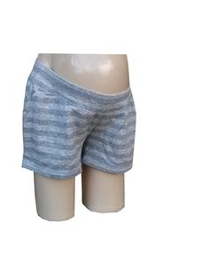 - Gray striped lounge shorts - Underbelly waist, side pockets - Cotton and polyester - Brand tag blacked out - Product #473
