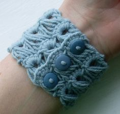 """Broomstick lace bracelet. And, I finally have a crochet hook big enough to use for the """"broomstick."""" Now, if I can just find some scrap yarn..."""