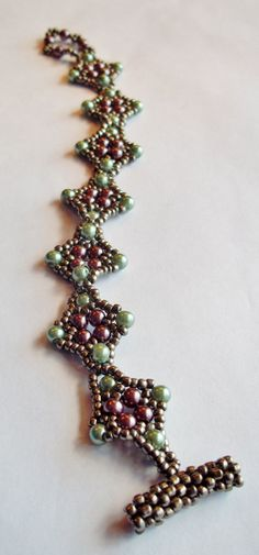 Gorgeous arabesque style bracelet in pastel purple and green.