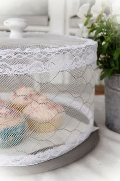What an awesome idea!!!! I love this!!! Cake Stand Cover Chicken Wire + Lace & Tulle = A simple way to keep mosquitoes and flies away!...