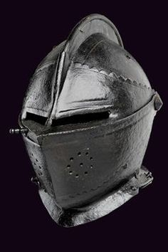 A closed helmet dating: late 16th Century provenance: Europe Two-halves skull, with remains of outlines, comb with longitudinal grooves at t...