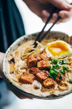 Ramen with tofu and an egg in a bowl.
