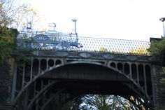 A life-size etching-like replica of the Jenny Lind, a steam locomotive commissioned by LBSCR railways in 1847. Sited over a disused railway bridge in Brighton. Conceived and fabricated by Jon Mills. www.metaljon.com
