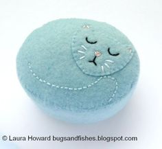 Today I'm sharing a tutorial for all you cat fans: how to make a sweet felt pincushion in the shape of a sleeping kitty!  This project originally appeared in docrafts Creativity magazine, last summer.