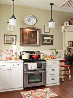 Celery Green on the walls and I like the mixed hardware on the cabinetry. Also like the hanging lights. Very nice!