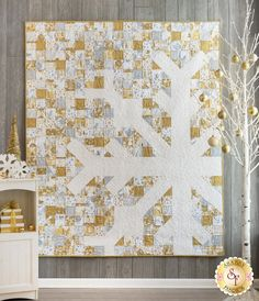 """This glorious Holiday Village Snowflake Quilt Kit will give your home a welcome change from the traditional reds and greens found in most Christmas décor. Not only does the striking snowflake stand out, but each of the fabrics around it have subtle gold and silver metallic accents within the winter prints, adding even more excitement to this work of art! This quilt was designed by Modern Handcraft.Quilt finishes to approximately 60"""" x 72""""This Kit Includes: Pattern All fabrics Snowflake Quilt, Snowflakes, Quilt Kits For Sale, Fabric For Sale Online, Shabby Fabrics, Christmas Fabric, Christmas Décor, Christmas Sewing, Winter Quilts"""