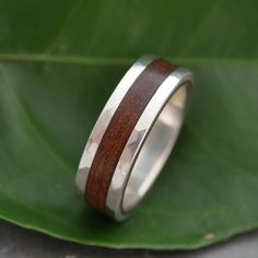 Hammered Lados Nacascolo Wood Ring - recycled sterling silver and sustainable wood wedding band. $252.00, via Etsy.