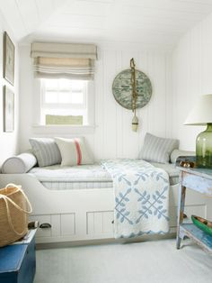 "This former pantry morphed into the ""Ship's Room,"" where a built-in berth beckons guests to curl up with a good book. A wooden barrel top and a nautical buoy combine to make timeworn wall art.    Read more: Coastal Decorating Ideas - Beach Cottage Design - Country Living"
