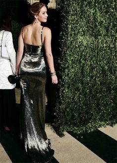 Jennifer Lawrence at 2013 Vanity Fair Oscars After-Party, holding her Best Actress Oscar for 'Silver Linings Playbook'. The new Oscar winner changed out of her white Dior gown to party in a more movement-friendly, slinky metallic Calvin Klein dress. Vanity Fair, Jennifer Lawrence Style, Award Show Dresses, Oscar Fashion, Prom Dresses Online, Silver Dress, Red Carpet Dresses, Strapless Dress Formal, Nice Dresses