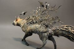 intricate clay sculptures by Ellen Jewett