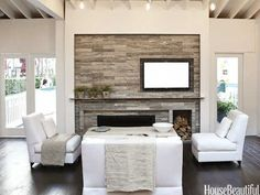 I love this fireplace where the TV and the fireplace are both off-center. Palladium Noir travertine tiles from Ann Sacks. Mick De Giulio Kitchen of the Year - The 2012 Kitchen of the Year - House Beautiful. Photos by Chris Eckert.