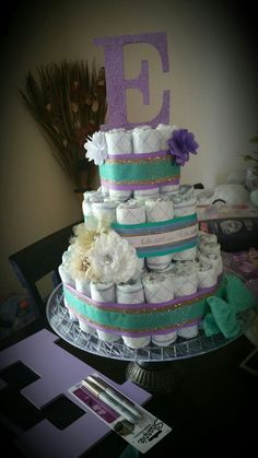 Diaper cake purple and teal and gold beautiful.