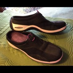 Cole Haan Nike Air Black Casual Mules Sz 8.5AA Cole Haan with Nike Air technology, casual, slip-on, mules.  Super comfortable!  Uppers black with leather trim in very good preowned condition.  Size 8.5AA *Note these are narrow fit. Cole Haan Shoes Mules & Clogs