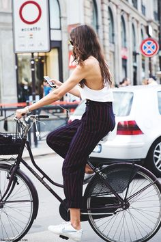 Milan Fashion Week Spring Summer 15 #MFW Street Style Striped Trousers and Nike Sneakers on Bike