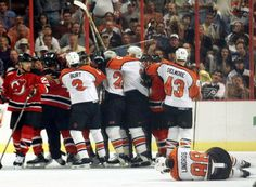 """""""Clash of the Titans"""": 2000 NHL Eastern Conference Finals: Scott Stevens lays out Eric Lindros in game 7.  The Devils go on to win the series and, ultimately, the 2000 Stanley Cup championship, while Stevens collects the Conn Smythe Trophy as playoff MVP."""
